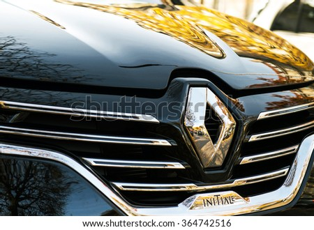 PARIS, FRANCE - OCT 30, 2015: Renault Initiale logo on a luxury sedan RENAULT ESPACE INITIALE PARIS. The Initiale logo is the flagship model and the most luxury one from Renault - stock photo