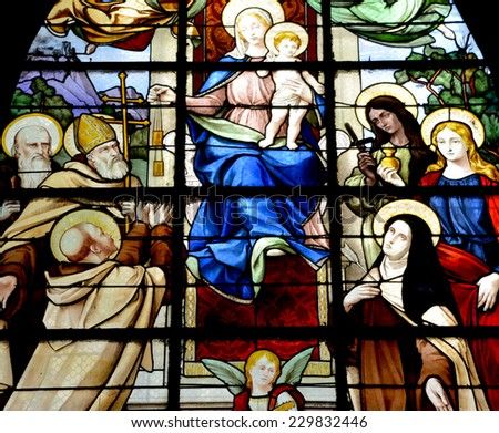 PARIS, FRANCE - OCT. 19: Stained glass window in the Church of Saint-Merri is a small church in Paris, located on the busy street Rue Saint Martin, on the Right Bank. Paris, France, on oct. 19, 2014, - stock photo