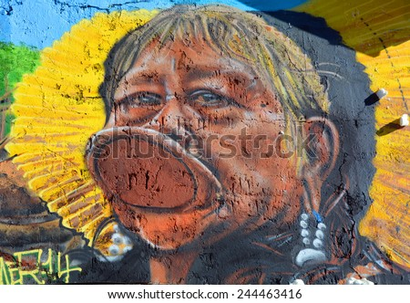 PARIS FRANCE OCT 19: Street art Indian tribe Kayapo in Paris France october 19 2014. Paris is the perfect place to walk in the back alleys and abandoned areas, looking for fresh air and street art.  - stock photo