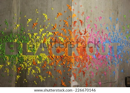 PARIS, FRANCE - OCT 4: Street art painting, Black Out colored origami in Halle Freyssinet in Paris,  October 4, 2014 in Paris, France.