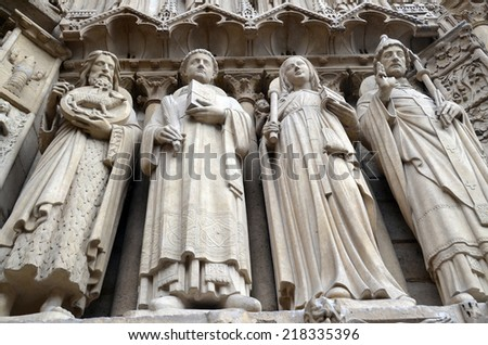 PARIS, FRANCE - OCT. 12: The Notre Dame cathedral of Paris details, France, on october 12, 2013, one of the most famous landmarks in Paris. In 2013, the cathedral celebrate its 850 years anniversary.  - stock photo