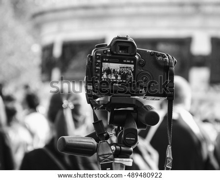 PARIS, FRANCE - OCTOBER 3, 2015: Canon camera shooting Zombie parade taking place at Place de la Republique. Zombie Walk is an annual event in Paris.