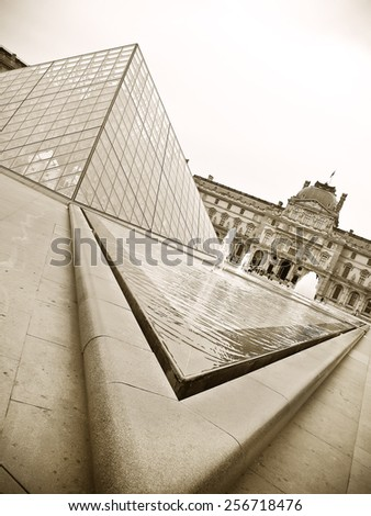 Paris, France - October 15 : Louvre museum and Pyramid on October 15, 2010. Louvre is the biggest Museum in Paris displayed over 60,000 square meters of exhibition space. - stock photo