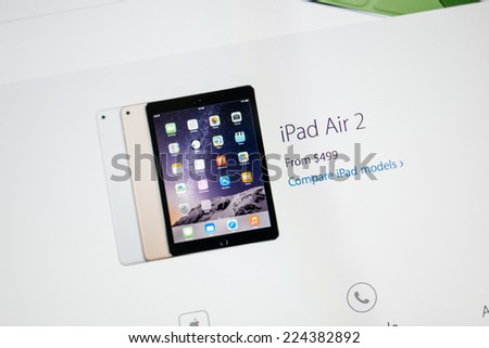 PARIS, FRANCE - 17 OCTOBER 2014: Photo of Apple iPad tablet with apple.com webpage. Apple unveiled the new iPad Air 2 and iPad Mini 3, iMac with 5K Retina display and the new Mac Mini - stock photo