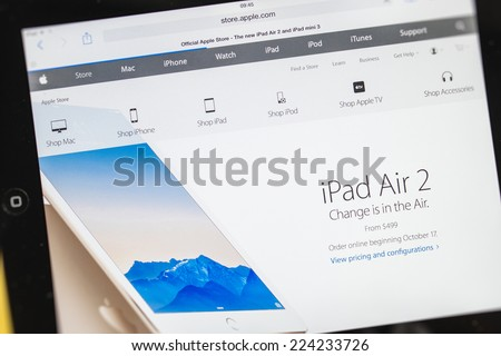 PARIS, FRANCE - 17 OCTOBER 2014: Photo of Apple iPad tablet with apple.com webpage of the new iPad Air 2 and iPad Mini 3 featuring new slogan. Apple unveiled the new iMac iPad Air 2 and iPad Mini 3 - stock photo