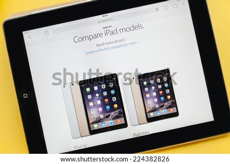 PARIS, FRANCE - 17 OCTOBER 2014: Photo of Apple iPad tablet with apple.com webpage of the new iPad Air 2 and iPad Mini 3. Apple unveiled the new iMac iPad Air 2 and iPad Mini 3 on 16 Oct - stock photo