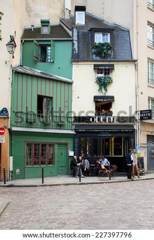 PARIS, FRANCE - OCTOBER 9, 2014:  Saint-Michel Latin Quarter street scene in Paris France. - stock photo