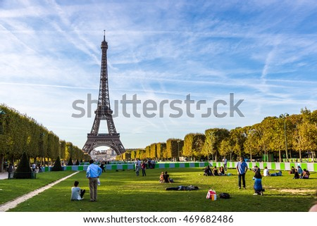 Paris, France - October 1st. 2014 - Tourists in the Eiffel Tower, the most iconic symbol of France full of tourists on a summer day, Paris, France, Europe