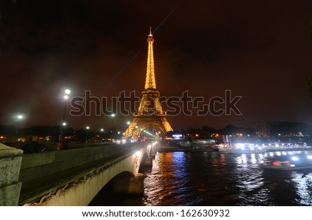 PARIS, FRANCE OCTOBER 14: The Eiffel Tower (Tour Eiffel) at night on october 14, 2013 in Paris, France. It was built between 1887 and 1889 for the World's Fair (Expo 1889).