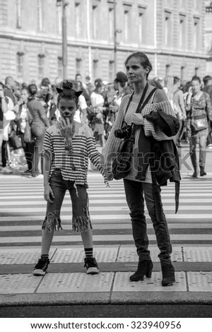 PARIS, FRANCE - OCTOBER 3, 2015: Unidentified zombie girl with her mother participating in Zombie parade at Place de la Republique. Zombie Walk is an annual event in Paris. - stock photo