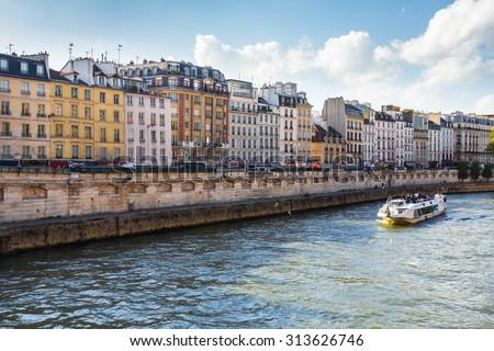 PARIS, FRANCE - OCTOBER 9, 2014:  View along the Seine River in Paris France - stock photo