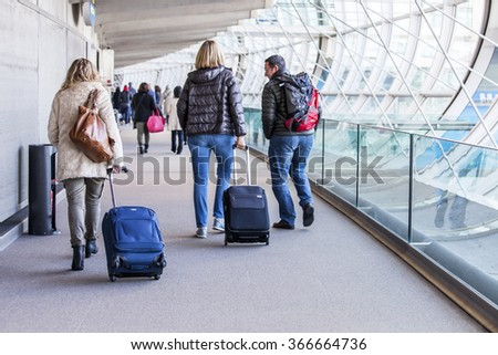 PARIS, FRANCE - on JANUARY 14, 2016. The international airport Charles de Gaulle, passengers go on pass to the hall of arrival - stock photo