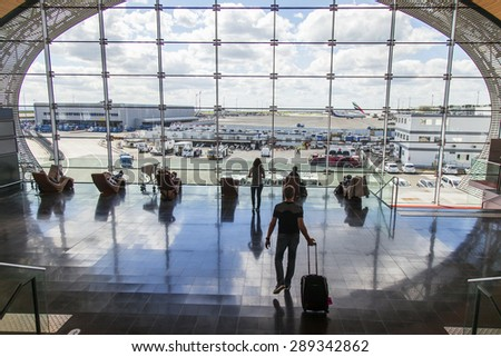 PARIS, FRANCE - on MAY 5, 2015. The international airport Charles de Gaulle, the hall of a departure in the terminal E. A survey platform with a panoramic glazing - stock photo