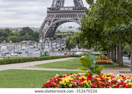 PARIS, FRANCE, on SEPTEMBER 1, 2015. A view of the Eiffel Tower and Iena Bridge (focus on a tower). The Eiffel Tower is one of the most visited and recognizable sights of the world - stock photo