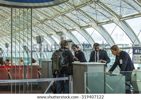 PARIS, FRANCE - on SEPTEMBER 1, 2015. The international airport Charles de Gaulle, passengers in a hall of a departure expect boarding - stock photo