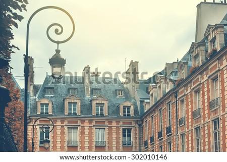 Paris, France. Place des Vosges. Retro filter effect - stock photo