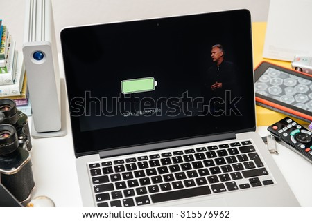 PARIS, FRANCE - SEP 10, 2015: Apple Computers website on MacBook Pro Retina in a creative room environment showcasing Philip Schiller from Apple talking about battery life of iPad Pro - stock photo