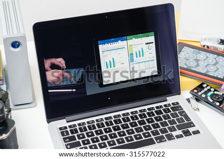 PARIS, FRANCE - SEP 10, 2015: Apple Computers website on MacBook Pro Retina in a creative room environment showcasing the newly announced iPad Pro and Microsoft Office - stock photo