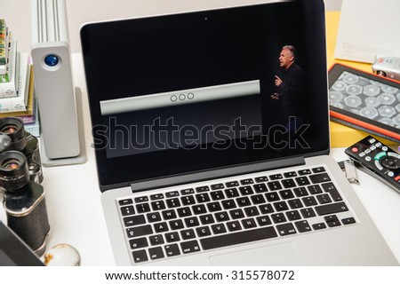 PARIS, FRANCE - SEP 10, 2015: Apple Computers website on MacBook Pro Retina in a creative room environment showcasing Philip Schiller from Apple talking about Smart Keyboard of iPad Pro - stock photo