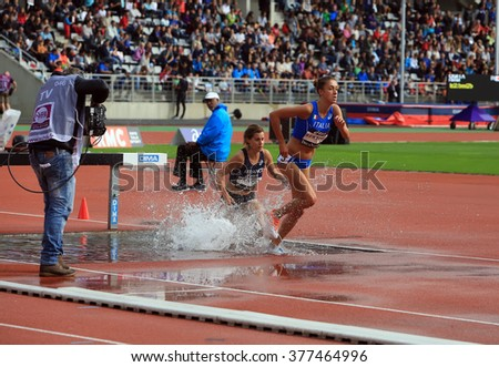 PARIS, FRANCE - SEP.13: Francesca Bertoni from Italy and Maeva Danois from France compete on the 3000 meters steeple on DecaNation International Outdoor Games on September 13, 2015 in Paris, France