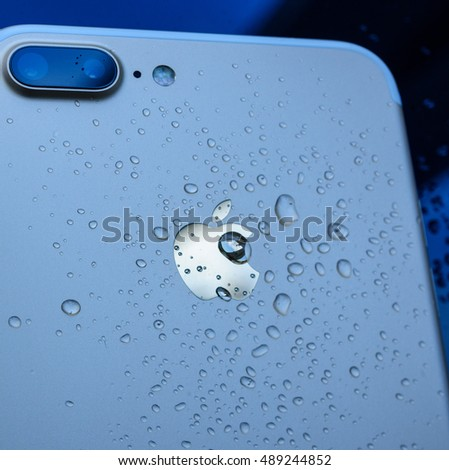 PARIS, FRANCE - SEP 26, 2016: New Apple iPhone 7 Plus unboxing and testing - drops on apple logo on rear of the phone. New iPhone7 is one of the best waterproof smart phone in the world