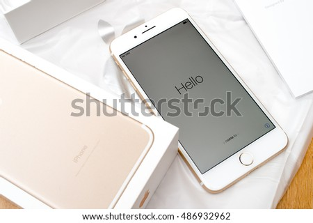 PARIS, FRANCE - SEP 16 2016 New Apple iPhone 7 Plus unboxing in the first day of sales -  Hello text on first run. New Apple iPhone acclaims to become the most popular smart phone in the world in 2016