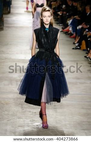 PARIS, FRANCE - SEPTEMBER 30: A model walks the runway during the Dries Van Noten show as part of the Paris Fashion Week Womenswear Spring/Summer 2016 on September 30, 2015 in Paris, France.  - stock photo