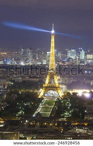 PARIS, FRANCE - SEPTEMBER 21, 2011: Eiffel Tower seen from Montparnasse tower on September 21, 2011 in Paris. Eiffel tower is the most visited monument of France with 6 million visitors every year.  - stock photo