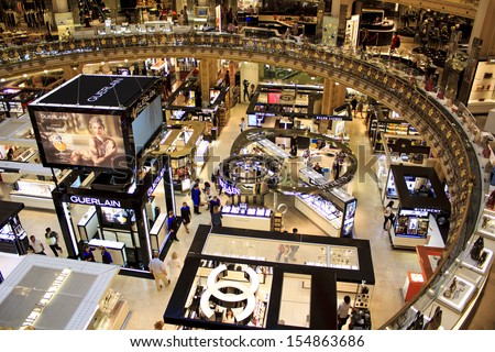 PARIS, FRANCE - SEPTEMBER 4 : inside part of the famous Galeries Lafayette with it's brand stands stalls such as Chanel and Lancome on September 4th 2013 in Paris, France - stock photo