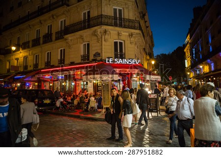 PARIS, FRANCE - SEPTEMBER 9, 2014:  Latin Quarter of Paris, France. Narrow street of Paris among old traditional parisian houses and cafe in Paris.  - stock photo