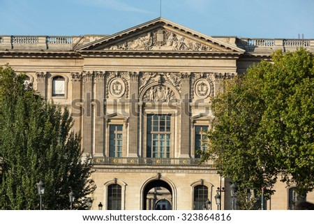 PARIS, FRANCE - SEPTEMBER 9, 2014: Paris - The Louvre Museum. Louvre is one of the biggest Museum in the world, receiving more than 8 million visitors each year. Paris, France - stock photo