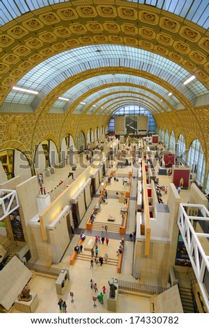 PARIS, FRANCE - SEPTEMBER 12, 2013: People in the Musee d'Orsay. Opened in 1986, the museum houses the largest collection of impressionist and post-impressionist masterpieces in the world - stock photo