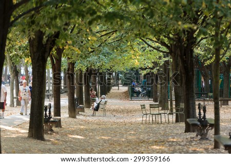 PARIS, FRANCE - SEPTEMBER 8, 2014: People relax in Luxembourg Gardens in Paris, France. Luxembourg area is popular among tourists in Paris, the most visited city worldwide. - stock photo