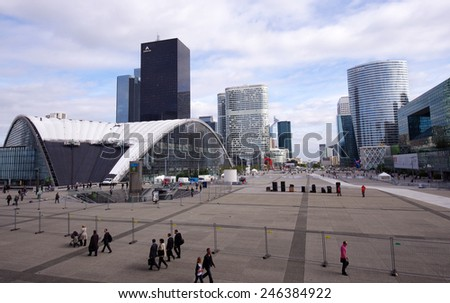 PARIS, FRANCE - SEPTEMBER 21, 2011: Photo of the main square in La Defense district, large modern business centre in the western part of Paris, France.  - stock photo