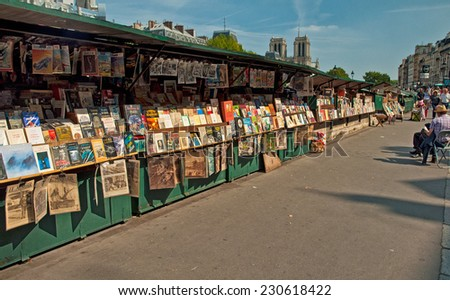 PARIS, FRANCE - 07 SEPTEMBER, 2014: Second-hand book market on quay of river Seine near cathedral Notre Dame de Paris on 7 September 2014. It is based in 16 century.  - stock photo