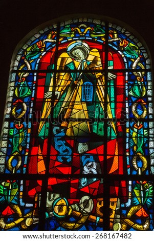PARIS, FRANCE - SEPTEMBER 10, 2014: Stained glass in the Church of St. Peter in Montmartre. Paris, France - stock photo