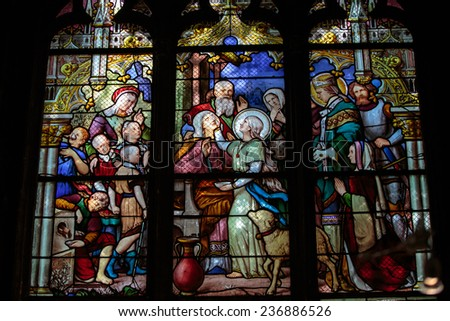 Paris, France - September 8, 2014: Stained glass window in the Church of Saint-Severin is a Roman Catholic church in the Latin Quarter of Paris, France - stock photo