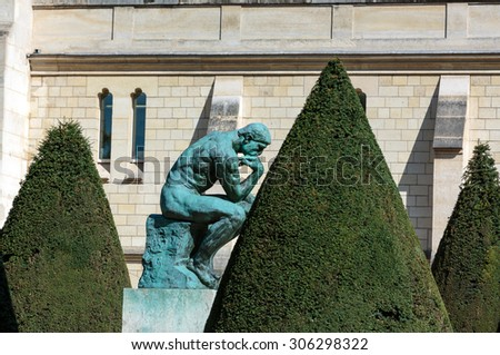 PARIS, FRANCE - SEPTEMBER 12, 2014: The Thinker in Rodin Museum in Paris - stock photo