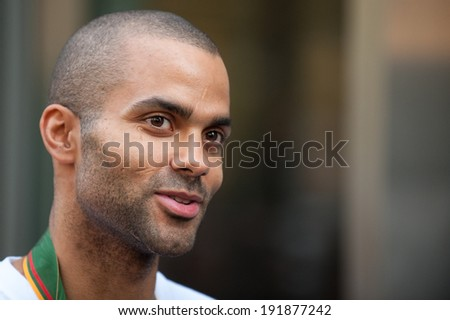 PARIS, FRANCE - SEPTEMBER 19, 2011 - Tony Parker in the Nike store on the Champs Elysees after the silver medal of the French basketball team at the European