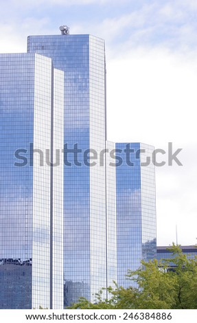 PARIS, FRANCE - SEPTEMBER 21, 2011: Tour Total is an office skyscraper located in La Defense, Courbevoie, the high-rise business district west of and adjacent to the city of Paris, France  - stock photo