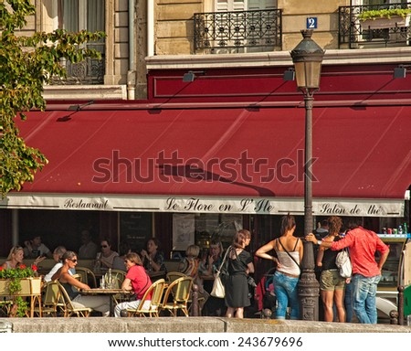 PARIS, FRANCE - 07 SEPTEMBER, 2014: Typical bar in the old town of Paris, France on 7 September 2014. Paris is one of the most populated metropolitan areas in Europe full of bars and cafes.  - stock photo