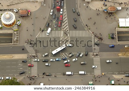 PARIS, FRANCE - SEPTEMBER 21, 2011: view from top of Eiffel Tower down to a busy intersection with cars and people in Paris, France. Photo taken on September 20, 2011.  - stock photo