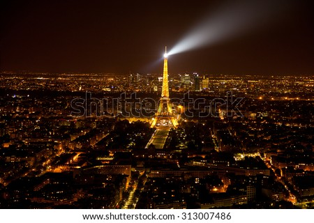 Paris, France - September 06, 2011 : View of Eiffel Tower during the light show from the top of Montparnasse Tower