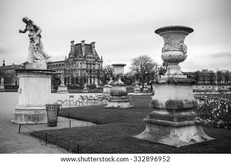 PARIS, FRANCE: Tuileries Garden in Paris, France. Tuileries Garden (Jardin des Tuileries) is a public garden located between the Louvre Museum and the Place de la Concorde. Black and white scene. - stock photo