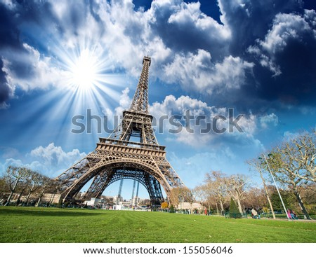 Paris, France. Wonderful view of Tour Eiffel with gardens and colourful sky. - stock photo