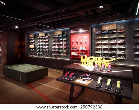 Paris. FRENCH-February. 6 2015;Nike store in Pairs.Nike is one of famous sports fashion brands worldwide and it is one of the world's largest suppliers of athletic shoes and apparel. - stock photo