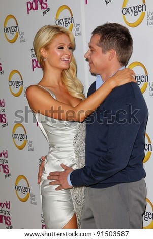"""Paris Hilton, Cy Waits at """"The World According to Paris"""" Premiere Party, Roosevelt Hotel, Hollywood, CA 05-17-11 - stock photo"""