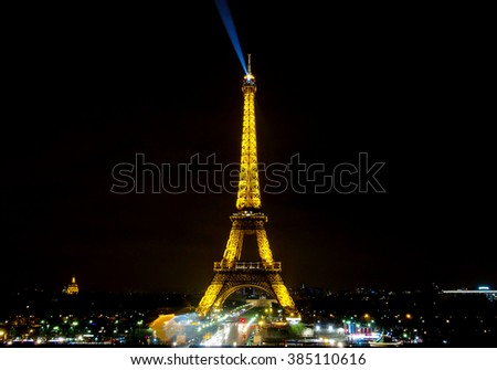 PARIS - JAN 1 : Light Performance Show of Eiffel tower with dark sky on Jan 1, 2016 in Paris. The tower is the most visited monument of Paris and France. - stock photo