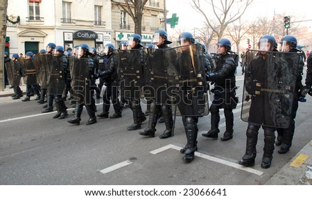 PARIS - JANUARY 10: French police unit Gendarmerie escourts demonstration against war in Gaza strip on January 10, 2009 at Place de la Nation, Paris, France.