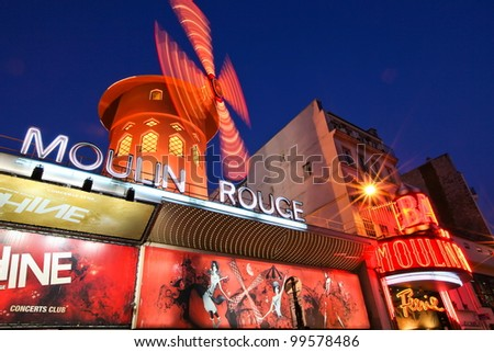 PARIS - JANUARY 16: The Moulin Rouge by night, on January 16, 2012 in Paris, France. Moulin Rouge is a famous cabaret built in 1889 and is located in the Paris red-light district. - stock photo
